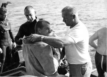 Dan Wilson is dressed by his tender, Jerry Ruse, before his record-setting dive off Santa Cruz Island. Warren Whitney assists in the background. (Jerry Ruse courtesy photo)