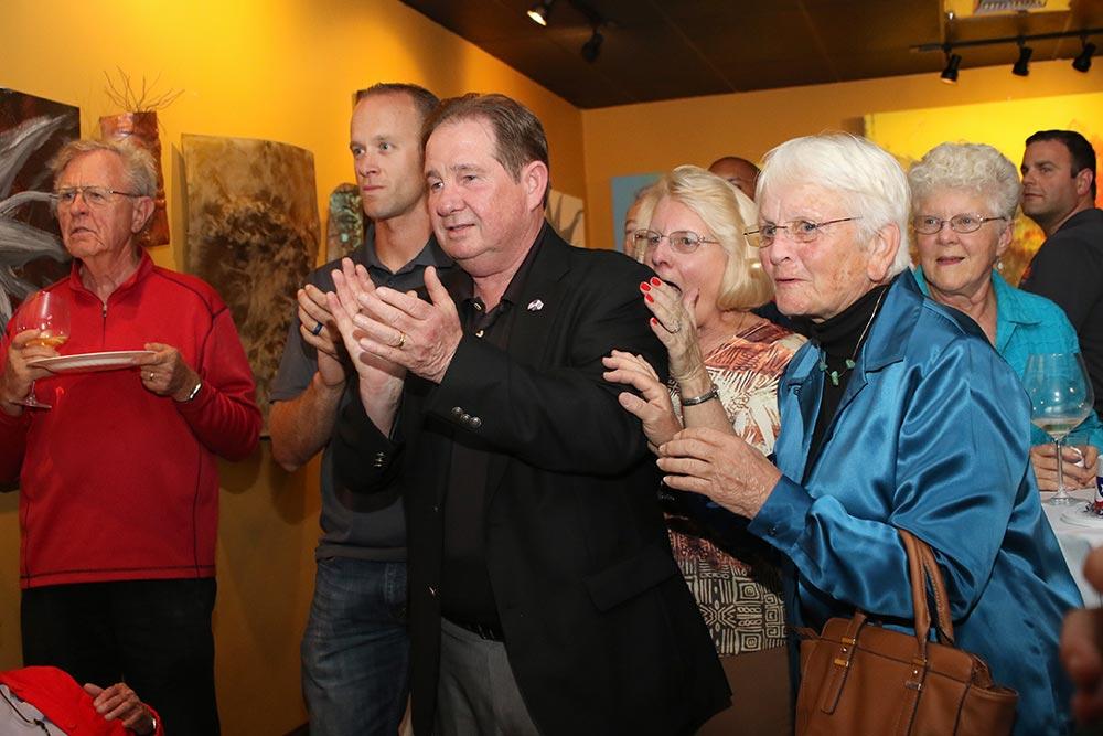 Lompoc Mayor Bob Lingl, middle, reacts with his supporters has the first set of results come in Tuesday night at D'Vine Wine Bar in Lompoc.