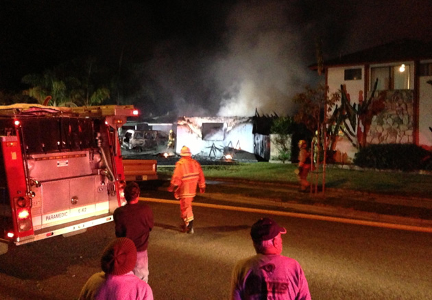 <p>The Carpinteria-Summerland Fire Department responds early Friday to a fire in the attached garage of a home on Delta Street.</p>