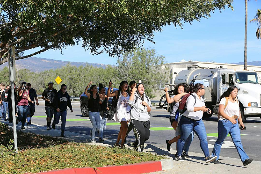 Dos Pueblos High School students leave campus to walk toward UCSB Wednesday.