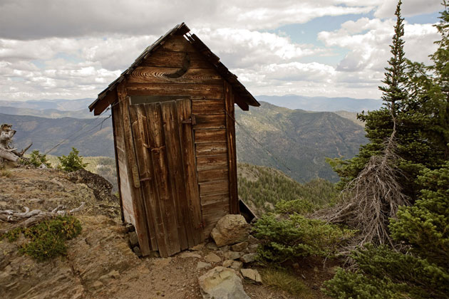 Safety-zone rule applies to wilderness privy near trailhead or parking lot.