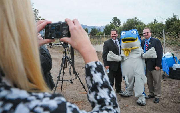 The City of Goleta's Steve Wagner, left, and Vyto Adomaitis pose for a photo with Sammy the Steelhead Trout at Thursday's groundbreaking for the San Jose Creek Improvement Project. The changes will widen the creek bed to prevent flooding and allow trout to use the creek in migrating to the ocean.