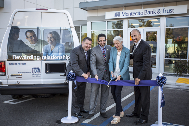 Easy Lift Transportation Executive Director Ernesto Paredes, right, celebrates with Montecito Bank & Trust Goleta Branch Manager Javier Quezada, left, Chief Operating Officer Rob Skinner and CEO Janet Garufis in cutting the ribbon on the bank's newest adopted Easy Lift vehicle. (Easy Lift Transportation photo)