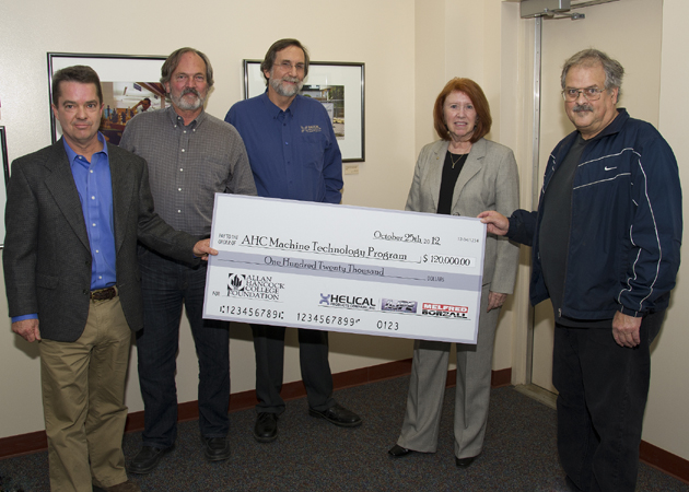 Four local manufacturing companies have partnered with Allan Hancock College to help fund the college's machining and manufacturing technology program. Pictured are, from left, Eric Melsheimer of Melfred Borzall, and Alex Ek and Leroy McChesney of Helical Products, along with Elizabeth Miller, Ed.D., Allan Hancock College interim superintendent/president; and Robert Mabry, AHC machine technology instructor.  The other industry partners who have donated are the Blaine Johnson Foundation and Karl Storz Imaging. (Allan Hancock College photo)