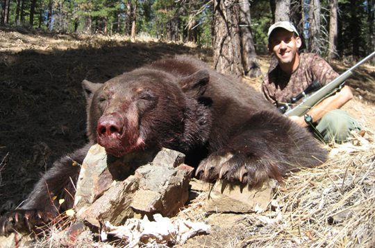 <p>John Nores with a 350-pound black bear from the northern Sierras.</p>