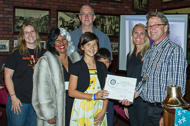 Adams Elementary School sixth-grade teacher Ashley Clausen, left, and Principal Amy Alzina, second from right, join Rotary Club of Santa Barbara North community service chairman Tom Jacobs, right, in honoring the Adams Family of the Month for October: Rachel (in Halloween garb) and Micah Babcock and their children, sixth-grader Hailey and third-grader Gregory. (Terry Straehley photo / Rotary Club of Santa Barbara North)