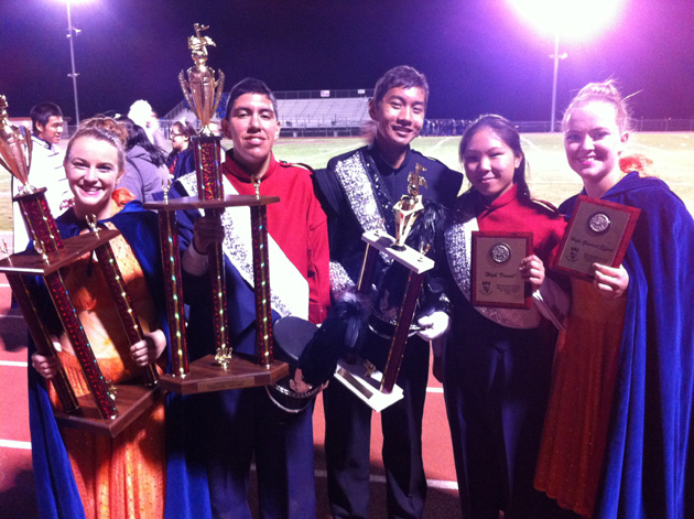<p>Members of the San Marcos High School Marching Band and Colorguard celebrate their first-place finish Saturday at the Oxnard Field Tournament.</p>