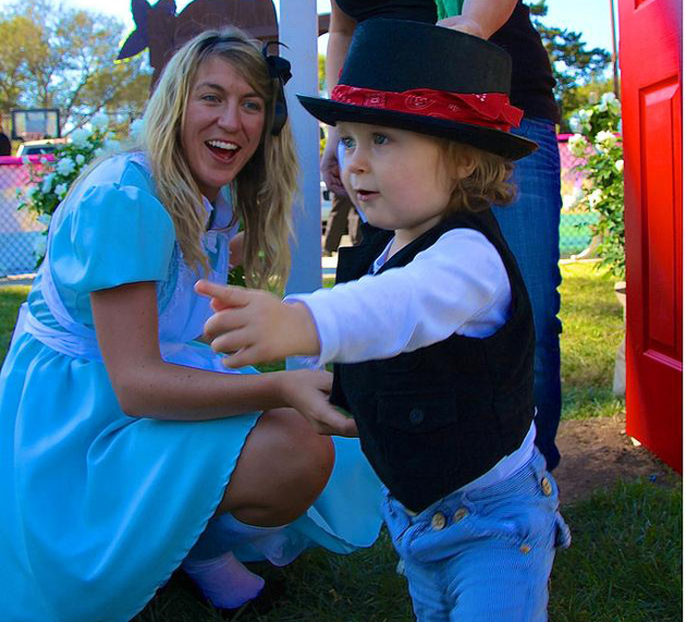 Laguna Blanca theater instructor Kate Bergstrom, aka Alice, greeted each guest who arrived at the school's Owls in Wonderland Carnival, encouraging them to run through the door to avoid shrinking. (Laguna Blanca School photo)