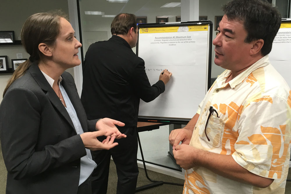 Goleta Planning Commission Chairwoman Katie Maynard talks to Paul Poirer of the American Institite of Architects while Goleta resident James Kyriaco writes down suggestions on a white board at Monday's Goleta Planning Commission workshop on accessory dwelling units.