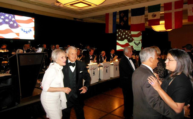 Veterans, service men and women, and guests enjoy dancing to a live orchestra at the Military Ball.