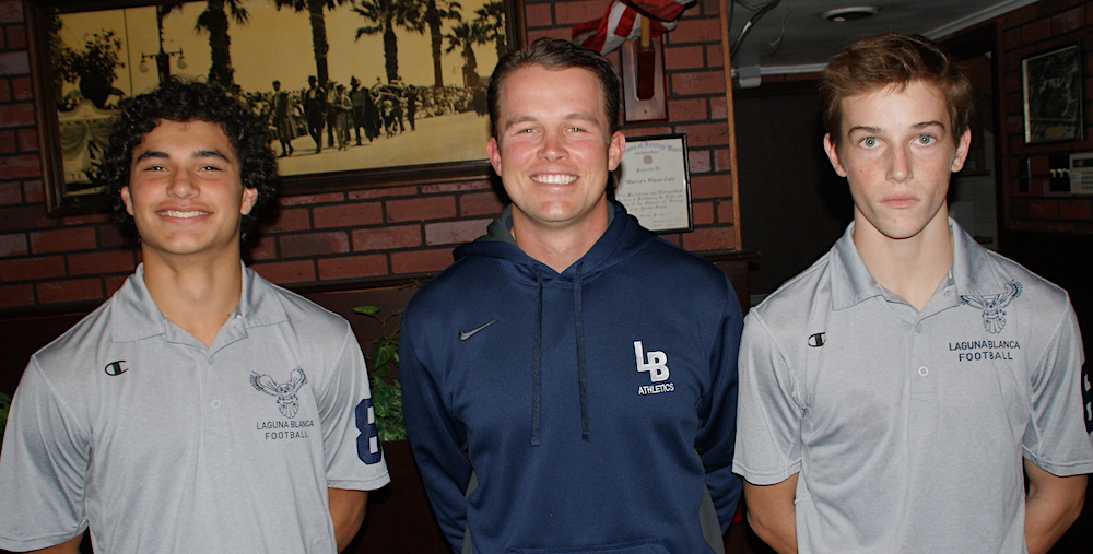 Laguna Blanca football coach Shane Lopes is joined by playes Ty Trosky, left, and Wells Fowler. The Owls will be playing a CIF-SS 8-man football semifinal game at home on Saturday.