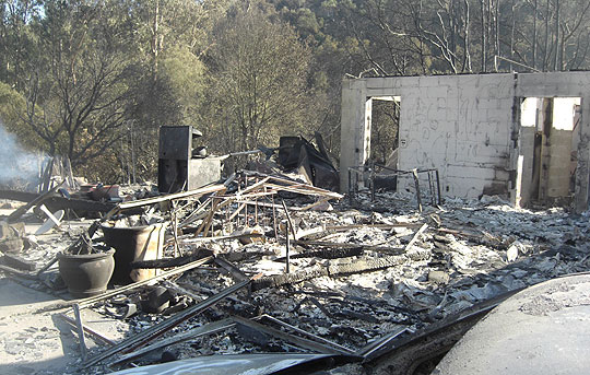 Many homes on lower Conejo Road were reduced to smoldering rubble by the fast-moving Tea Fire.