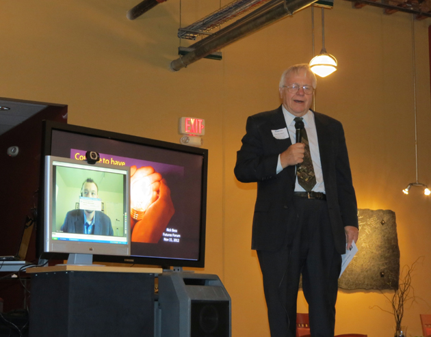<p>Ray Deutsch urges attendees of the EconNSBC &#8220;Futures Forum&#8221; in Santa Maria on Thursday to direct questions to virtual keynote speaker Simon Anderson, who answered remotely via webcam from Florida.</p>