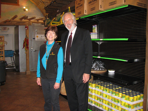 <p>Unity Shoppe Executive Director Tom Reed and public relations coordinator Pat Hitchcock join staff and volunteers in helping families pick out food for Thanksgiving dinners.</p>