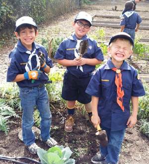 Carpinteria Cub Scouts from Pack 50 pitch in. (Farmers' West Flowers & Bouquets photo)