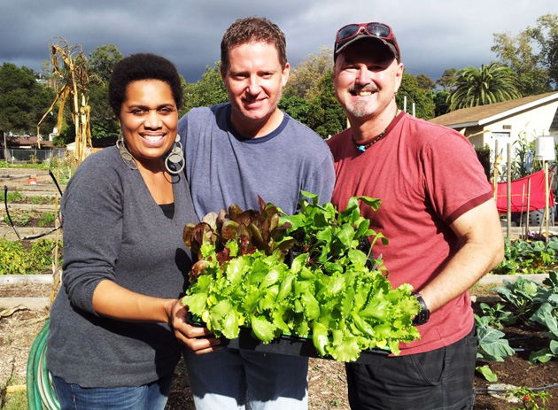 Alyce Hartman of Alyce Hartman Projects, which donated the seed money for the plots; John Thomas of Farmers' West Flowers & Bouquets, which donated plant material; and John JB Bowlin, a volunteer coordinator with Casa Esperanza, prepare to plant vegetables at the homeless shelter. (Farmers' West Flowers & Bouquets photo)