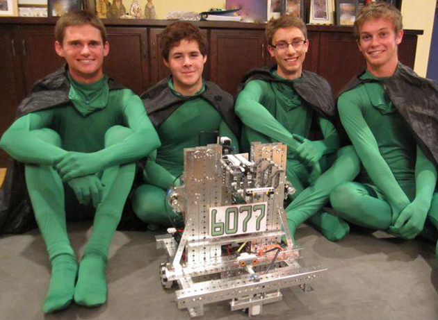 <p>Team 6077&#8217;s Andrew McGuan, from left, Collin Dutter, Ryan Weideman and Kyle Kovacs show off their robot — and costumes — after last Saturday&#8217;s FIRST Tech Challenge in Pasadena.</p>