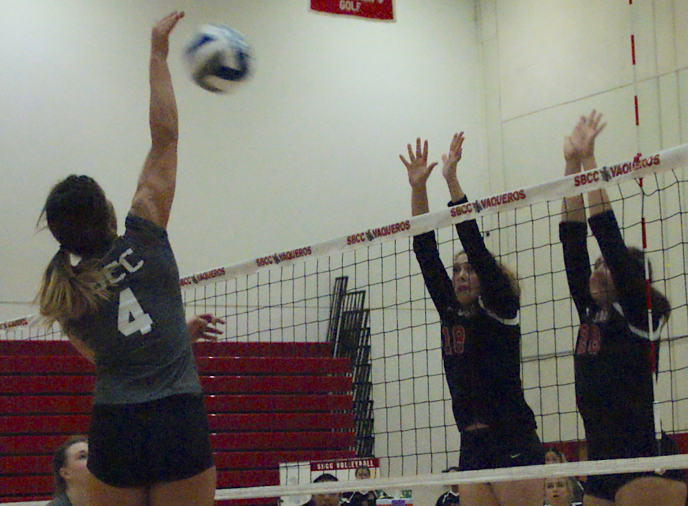 Kaylene Ureno of SBCC hits against a Long Beach block during Tuesday's Southern California Regional match.