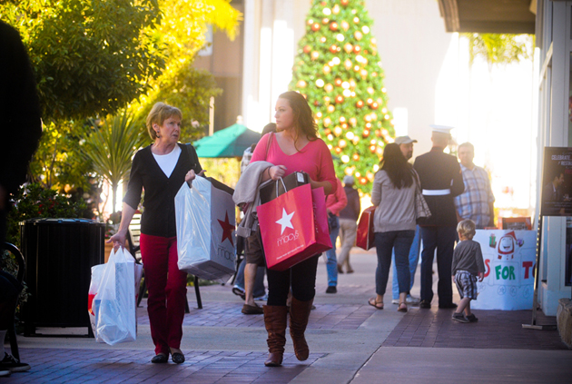 Shoppers leave Macy's with bags of purchases on Friday at La Cumbre Plaza in Santa Barbara. (Lara Cooper / Noozhawk photo)