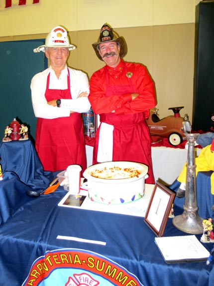 Bob Duncan and Mike Mingee of the Carpinteria-Summerland Fire Protection District dress the part.