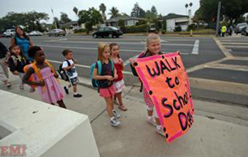 Adams Elementary students and parents form a walking school bus on Walk to School Day. (COAST photo)