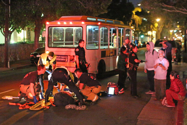 Emergency personnel attend to Ratan Bahadur Lamichhane, 66, of Michigan, who was fatally injured on Nov. 23 when he was struck by an MTD trolley on Anacapa Street in downtown Santa Barbara. Police say he was to blame in the accident.