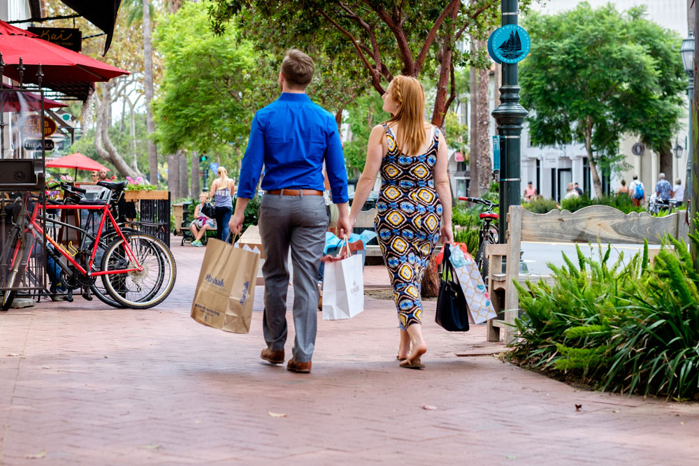 Shoppers stroll down State Street in Santa Barbara. This weekend, the Downtown Santa Barbara organization is leading its third Small Business Saturday event.