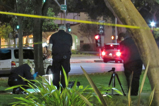 Detectives investigate Wednesday night after a man was critically wounded in an attack at the Santa Maria Town Center Mall.