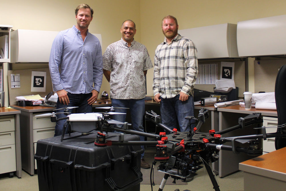 Hayden Gower, Victor Rasgado and Nick Kariger, from left, use drones as part of their surveying work at Stantec's Santa Barbara office.
