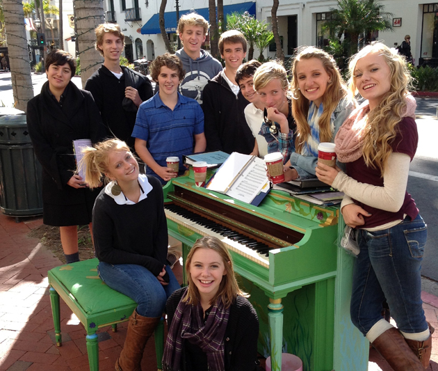 Providence Hall students rehearse for the Service of Lessons and Carols at one of the pianos recently located on State Street in Santa Barbara. (Providence Hall photo)