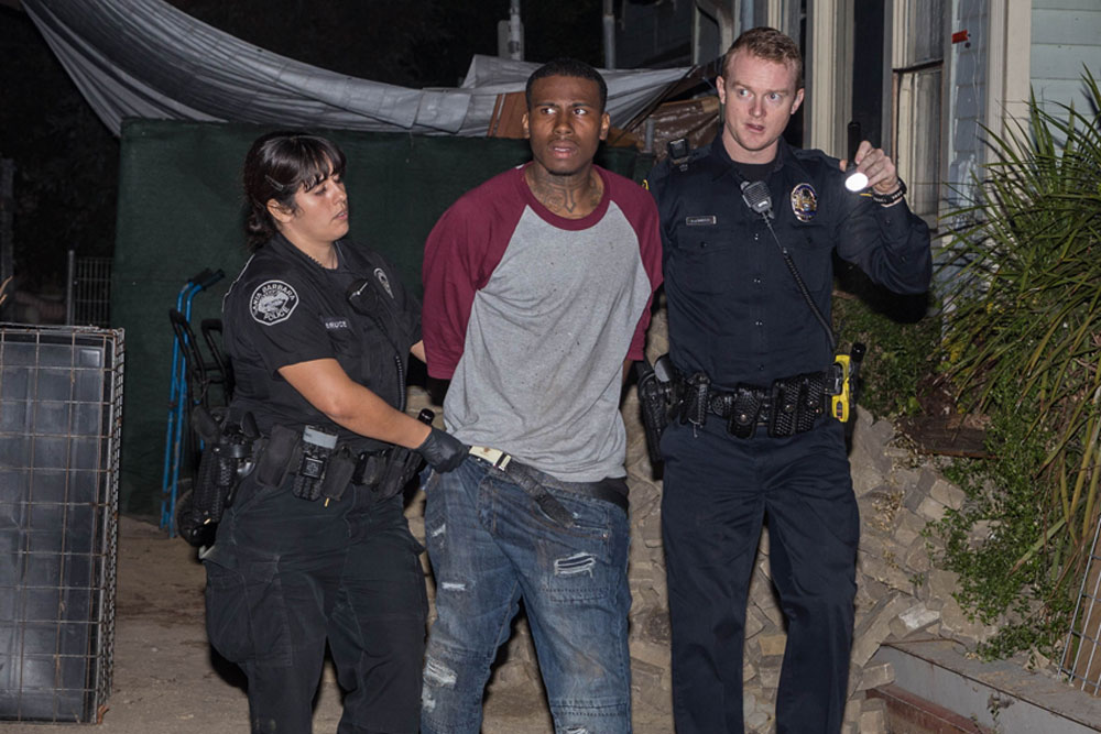 Justin Williams, 22, is taken into custody late Saturday as the suspect in a robbery on Santa Barbara's Lower Eastside.