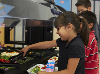 An Adams student relishes the array of offerings at the elementary school's new Apio-donated salad bar. (Apio Inc. photo)