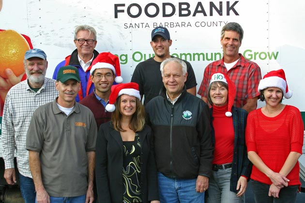 Local businesses owners, aka the Holiday Haulers, donate time, trucks and manpower to help the Foodbank of Santa Barbara County pick up and deliver donations during its annual Holiday Food Drive. (Montecito Landscape photo)