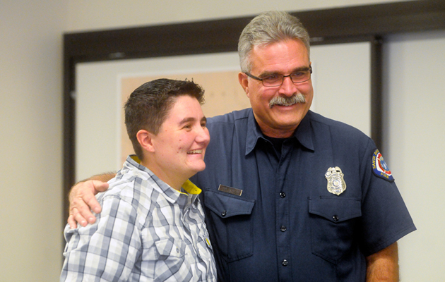 Santa Barbara fire engineer Jack Franklin hugs Timorie Millender at fire headquarters on Tuesday morning. Franklin will be presented with an award for heroism for saving Millender's life after she was hit by a motorcycle while crossing Patterson Avenue last year. (Lara Cooper / Noozhawk photo)