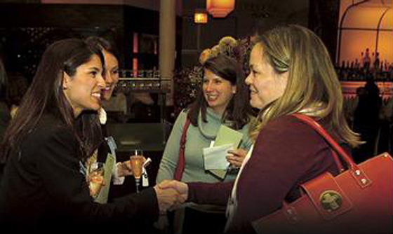 <p>Attendees mingle at a past networking event hosted by Women in Technology International and Women&#8217;s Economic Ventures to learn more about each other's businesses.</p>
