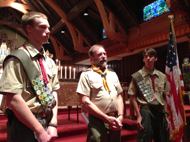 <p>Scoutmaster Otis Calef honors the advancement of Montecito Boy Scouts Charles Haslem, left, and Jeremy Work to the rank of Eagle Scout during a ceremony held Friday at All Saints-by-the-Sea Episcopal Church.</p>