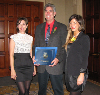 San Marcos High School automotive technologies teacher Russell Granger, standing with Goleta Valley Chamber of Commerce president and CEO Kristen Miller, left, and Sarah Clark from Cox, was named Educator of the Year. (Giana Magnoli / Noozhawk photo)