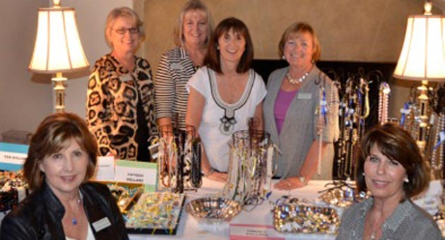 Surrounded by friends, Meredith Scott was right at home at the recent CALM (Child Abuse Listening Mediation) Wine Jewelry Chocolate benefit. From left, Sharon Hooper, Toni Schinnerer, Toni Kipp, Scott, Diane Dukes and Terri Fawcett. (Photos by Priscilla photo)