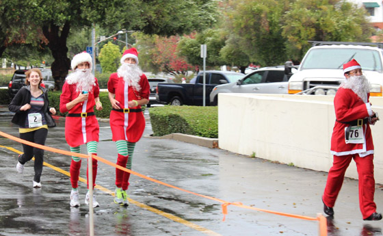 <p>Runners sport costumes in the spirit of last year&#8217;s Santa Barbara Santa Claus Run.</p>