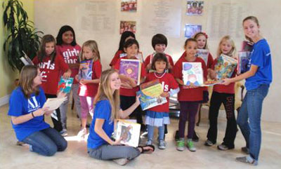 Representatives of Girls Incorporated of Greater Santa Barbara accept donated books from the Assistance League of Santa Barbara. From left to right are Assisteens Kelly Colee, Natalie Casey and Claire Casey. (Assistance League of Santa Barbara photo)