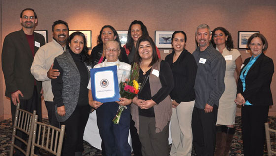 Participants of the Housing Authority of the City of Santa Barbara Family Self-Sufficiency program celebrate with community leaders during the recent FSS graduation ceremony. Pictured are seven of the eight current graduates with representatives from the offices of Assemblyman Das Williams, D-Santa Barbara, and Santa Barbara County Supervisor Salud Carbajal, and Housing Authority Resident Services leadership staff. (Marcus Lopez photo)