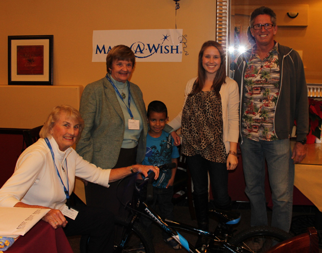 Make-A-Wish Tri-Counties, with the help of owner Bruce Davis and the employes at Hazard's Cyclesport, give a new bike to 7-year-old Anthony Torres of Santa Barbara. (Make-A-Wish Tri-Counties photo)