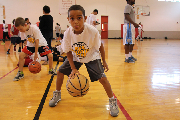 A camp participant demonstrates his dribbling skills at the Shooting Star Youth Basketball Camp.