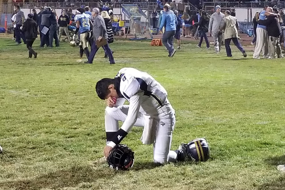 Dos Pueblos quarterback Jake Ramirez is overcome Friday night after the Chargers narrowly missed winning their first-ever CIF football championship. DP lost 26-21 to Quartz Hill when their last drive, with time running out, ended just short of the goal line.