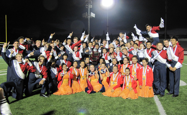 Members of the San Marcos High School Marching Band and Colorguard celebrate their gold-medal finish in the Southern California State Championship on Saturday at Ramona High School in Riverside. (San Marcos High School photo)