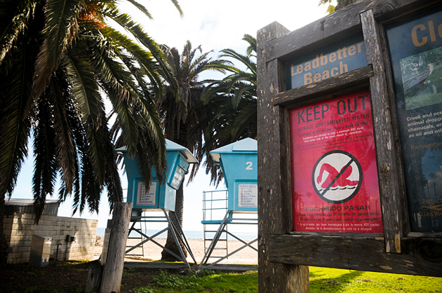 <p>Closure signs were posted Monday at Leadbetter Beach, warning the public about a sewage spill in the area.</p>