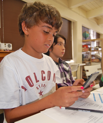 Sixth-grader Nico Laurie calculates his monthly budget. (Santa Barbara Middle School photo)
