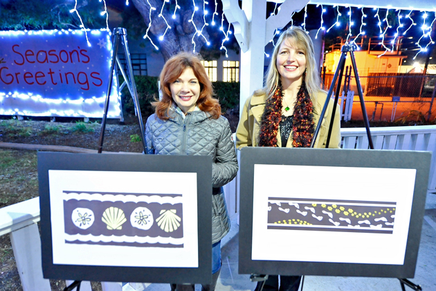 Contest winners Linda Powers and Michelle Schaerfer show off their Lompoc creative crosswalk designs.