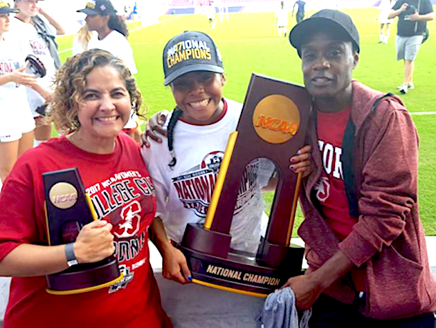 Kiki Pickett celebrates with her parents, Gena and Brian, after Stanford's 3-2 national-championship victory over UCLA in Orlando, Fla.