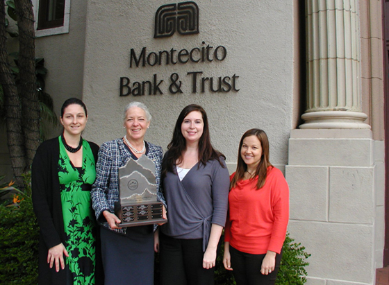 Montecito Bank & Trust's, Meredith Tynes, left, President/CEO Janet Garufis, Jamie Gilles and Brianna Aguilar are presented with the traveling trophy for building the largest team for the 12th Annual Summit for Danny. More than 50 climbers from the bank participated in this year's climb. (Council on Alcoholism and Drug Abuse photo)